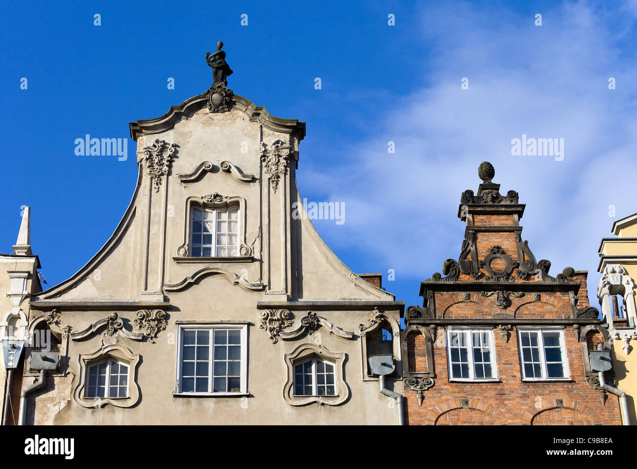 Ornate top of a tenement houses in the Old Town of Gdansk, Poland Stock Photo