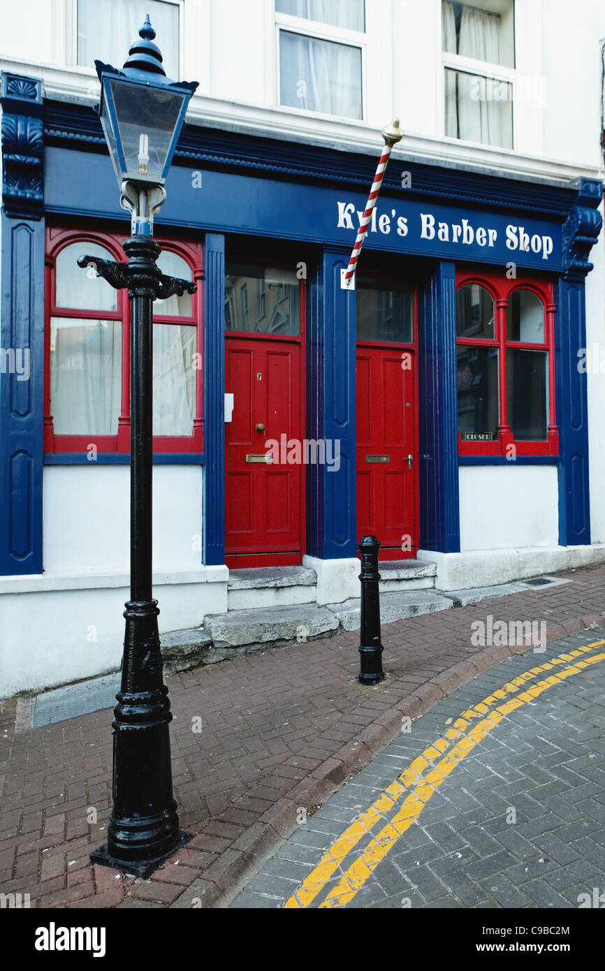 Cobblestone Street with an Old Barber Shop, Cobh, County Cork, Republic of Ireland Stock Photo