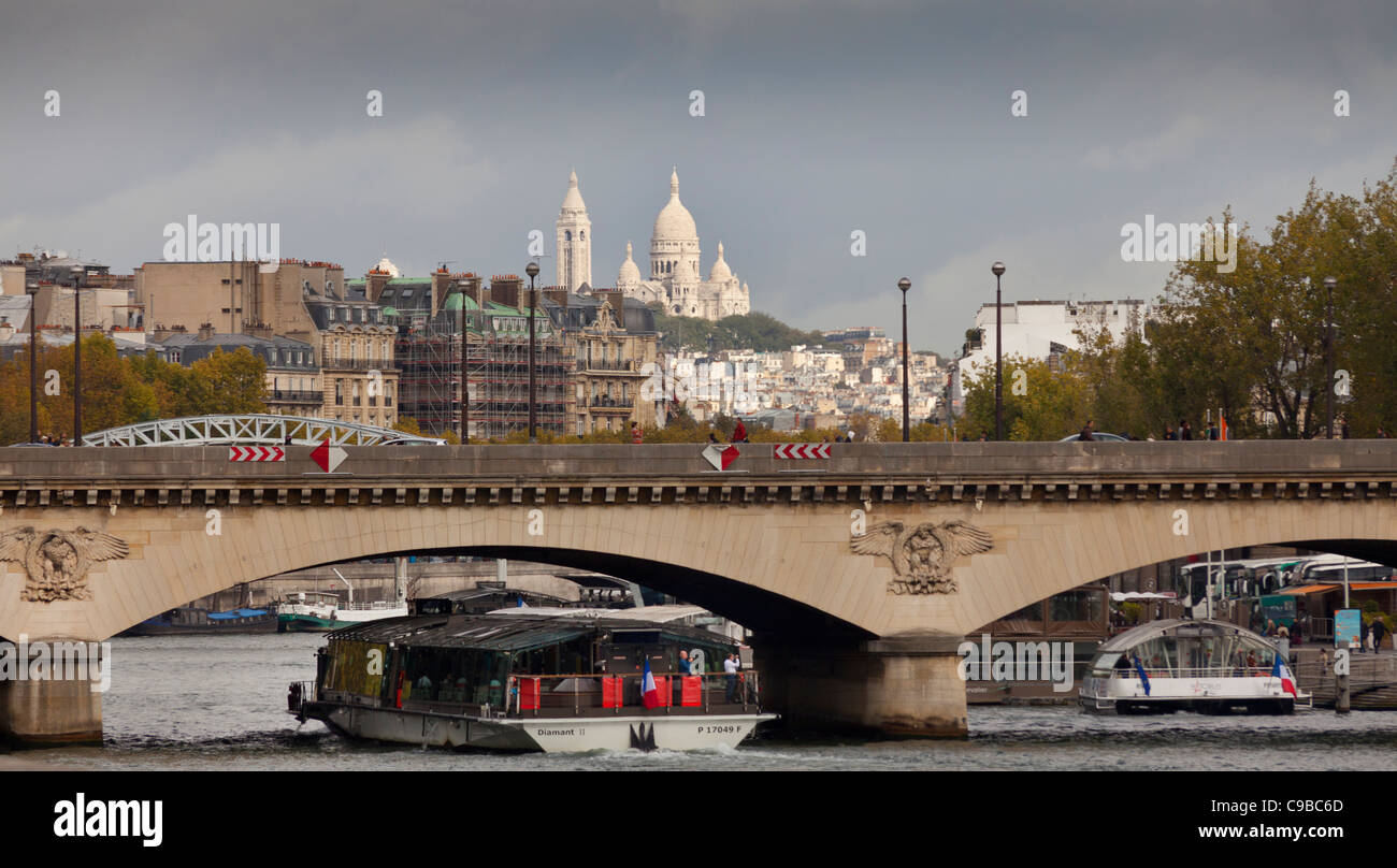 The Basilica of the Sacred Heart of Paris, commonly known as Sacré Cœur Basilica, viewed from the South bank of Stock Photo