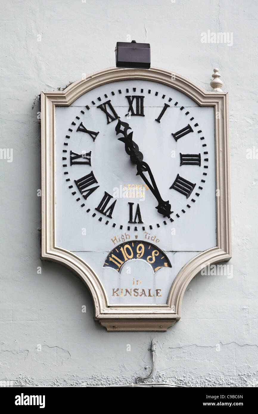 Close Up View of an Antique Wall Clock, Blue Haven Hotel, Kinsale, County Cork, Republic of Ireland - Stock Image