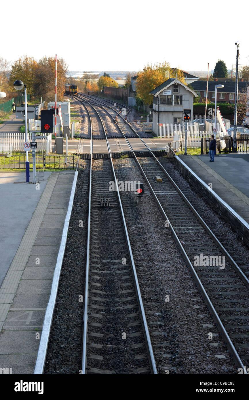 Rail track and level crossing at Worksop Railway Station Nottinghamshire, England. Uk - Stock Image