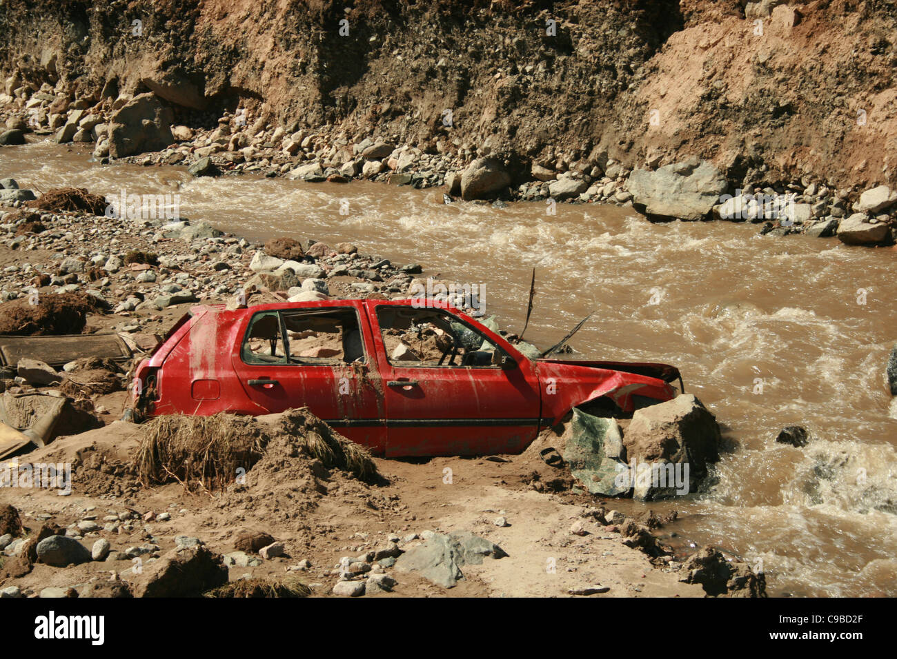 Car fallen into the river during debris-flow flood after glacial lake outburst, Zyndan valley, Tien-Shan, Kyrgyzstan Stock Photo