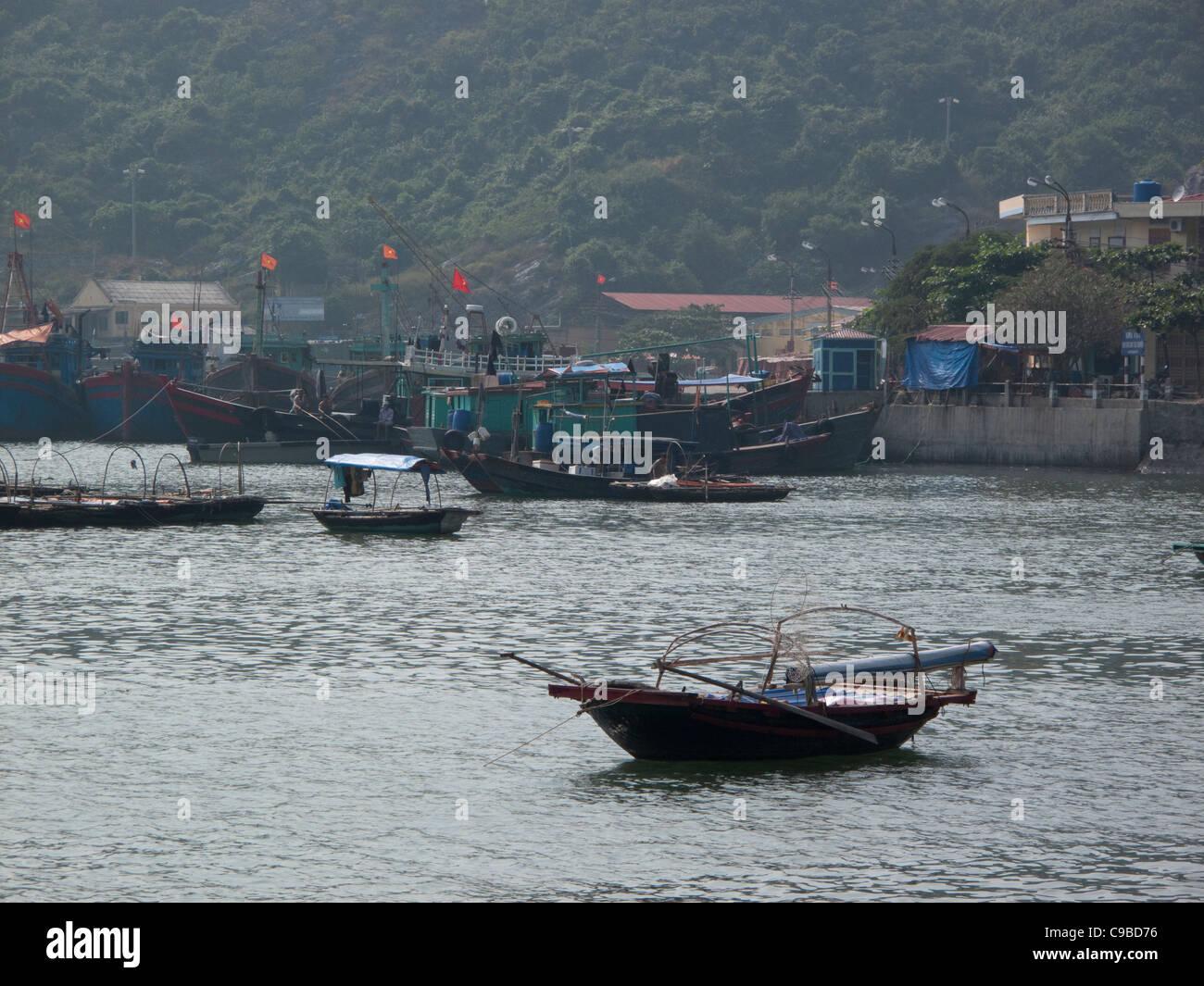 Fishing boats at Halong Bay on the South China Sea, Vietnam - Stock Image