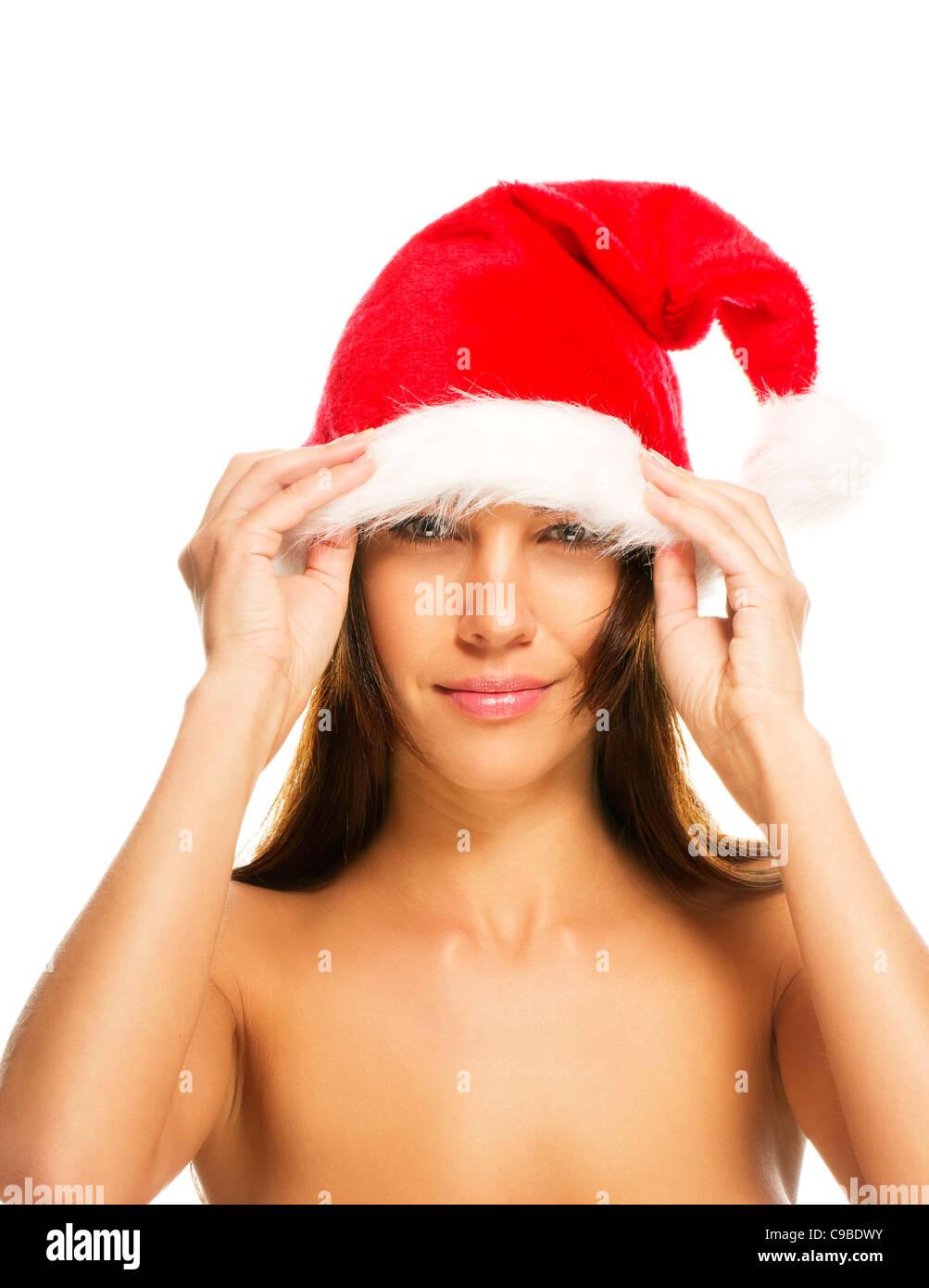 d9844bac beautiful brunette woman put on Santa's hat on white background ...