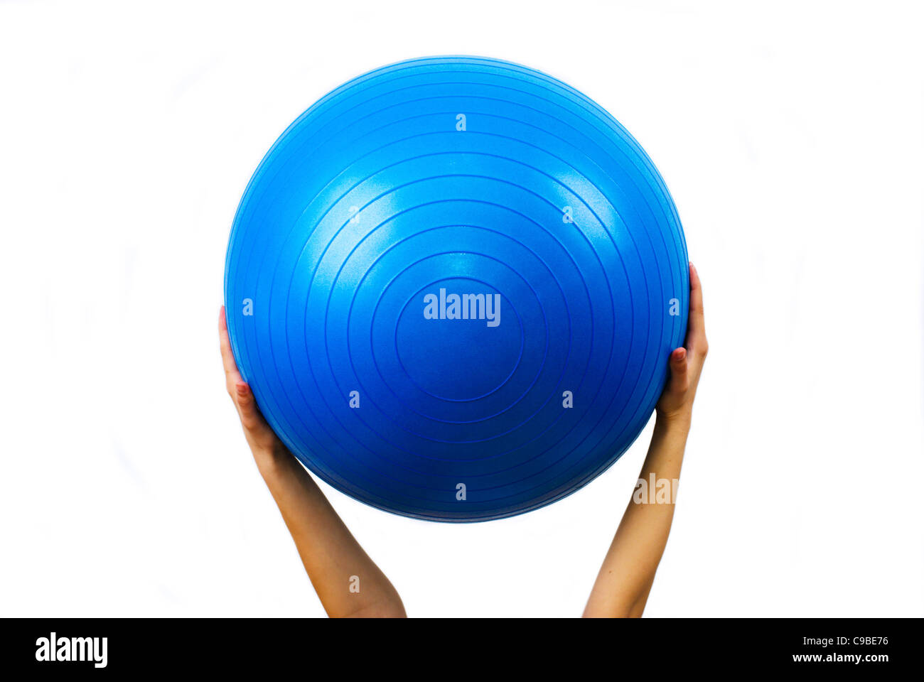 Blue fit ball in the hand - Stock Image