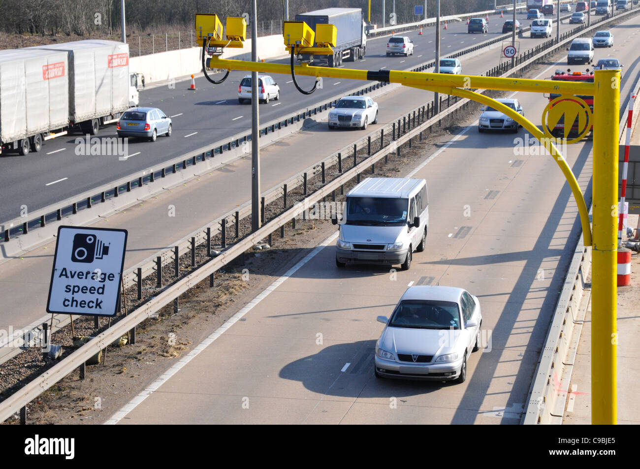 Average speed cameras & sign on the M25 motorway during contra flow operation & because of road works widening - Stock Image