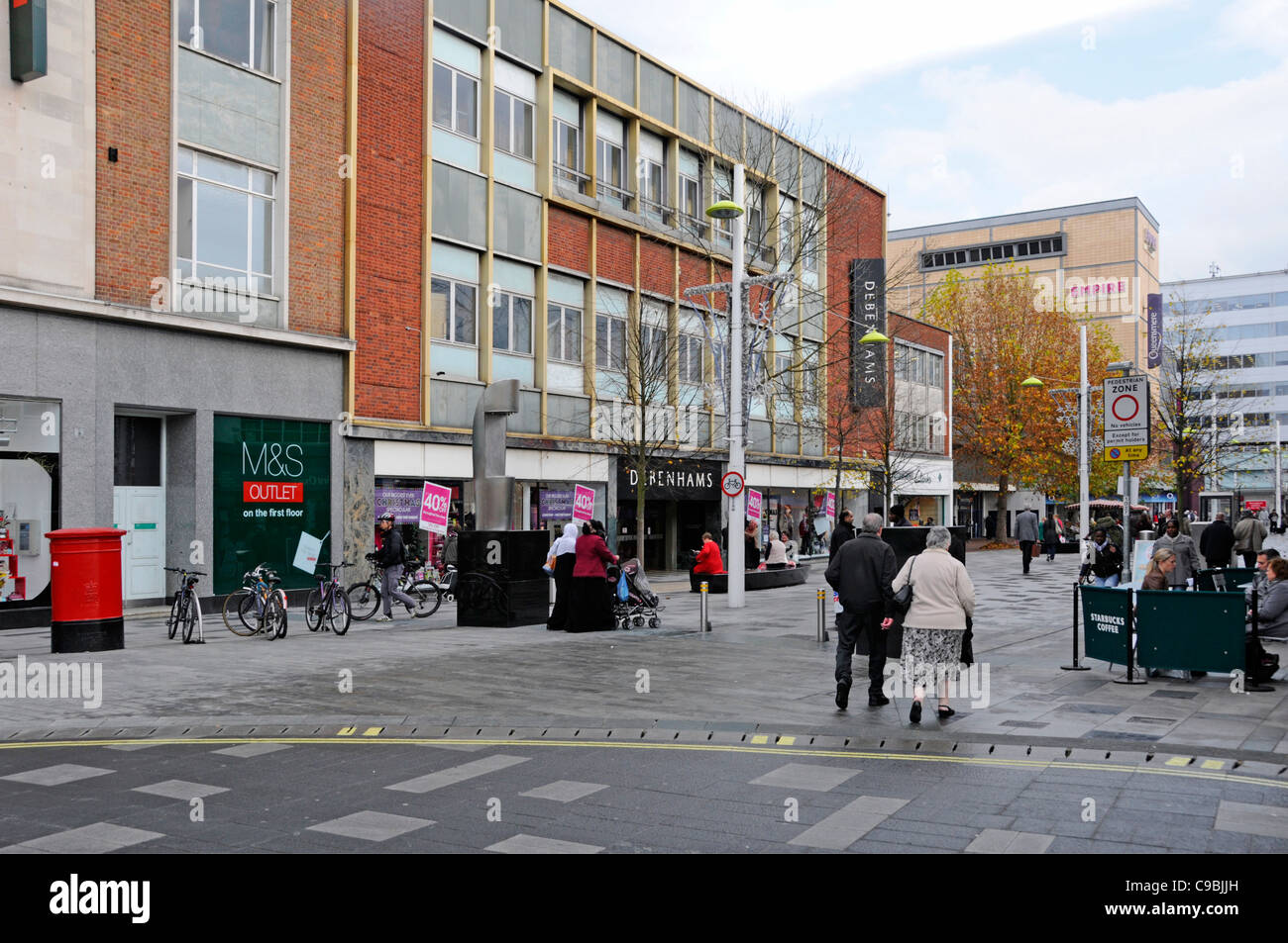 Autumn shoppers in Slough town centre High Street Berkshire England UK - Stock Image