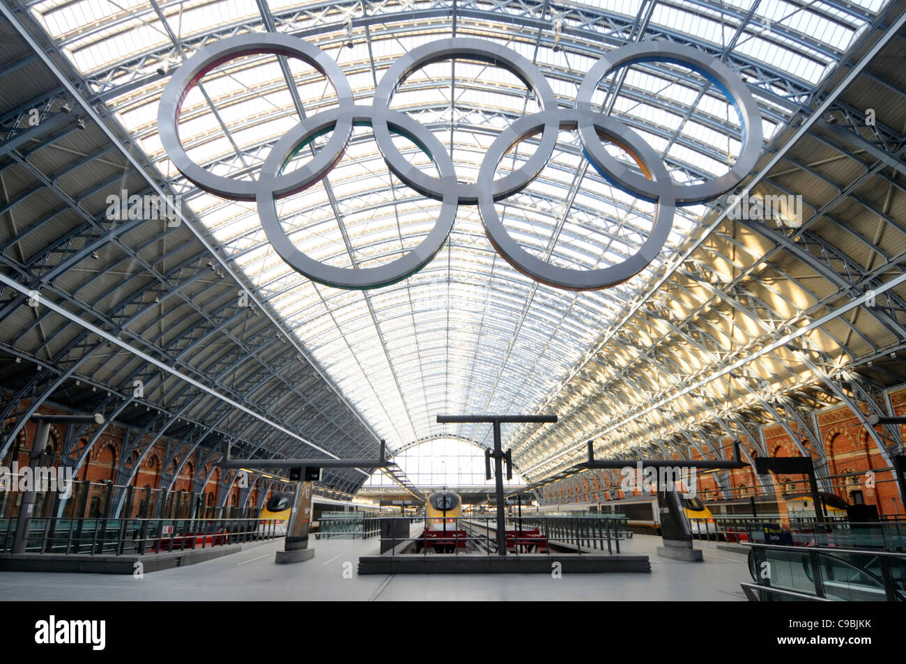 Olympic Rings suspended across the roof space of the Barlow Shed at St Pancras International Eurostar train station - Stock Image