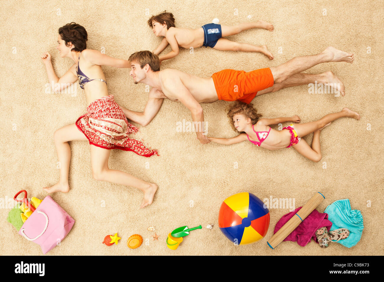 Germany, Artificial beach scene with family and beach toys - Stock Image