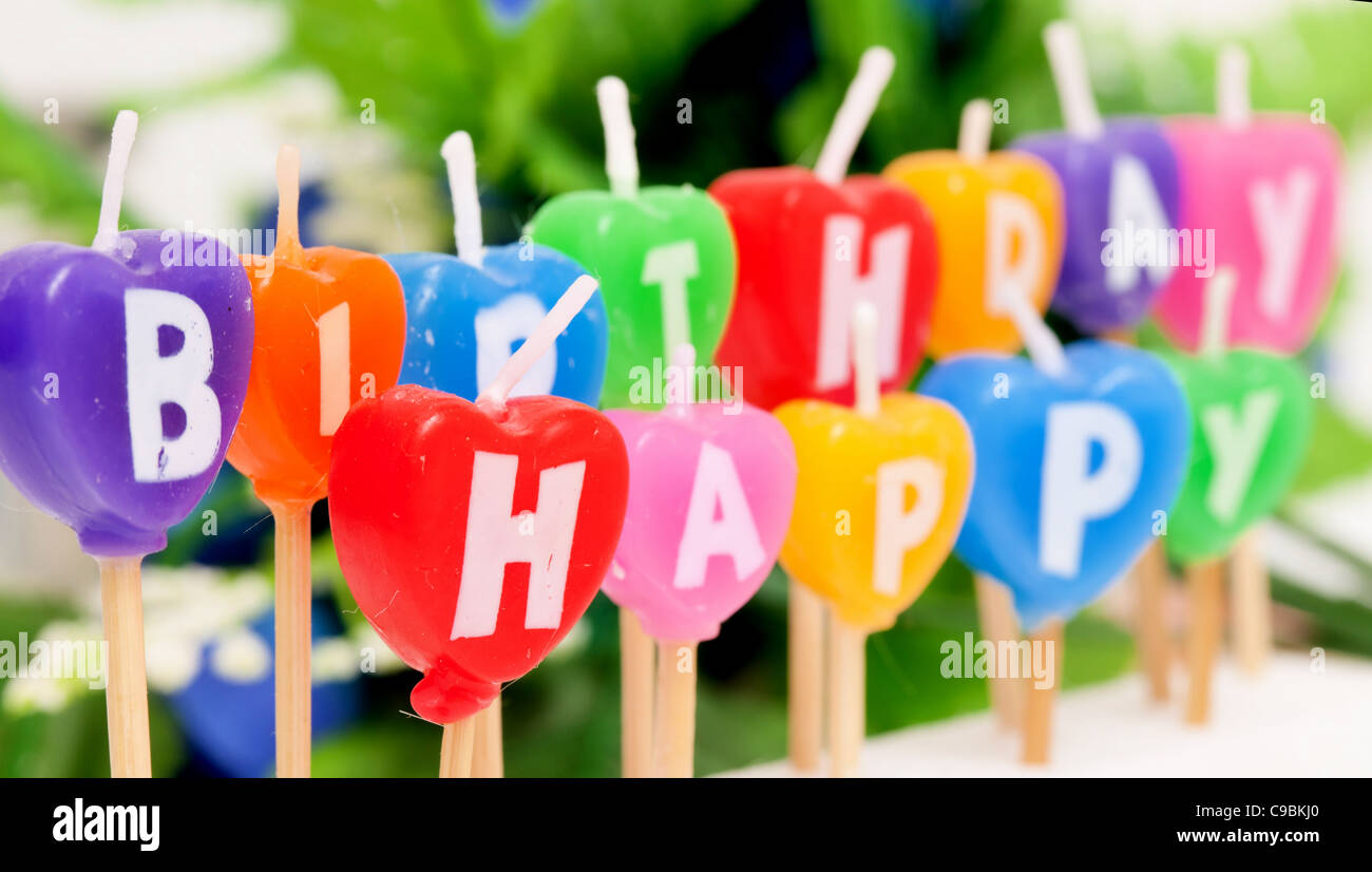 Color Candles with letters of happy birthday - Stock Image