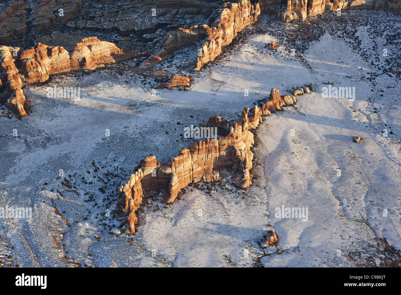 SANDSTONE OUTCROP IN A SNOWY FIELD (aerial view). Chesler Park Peak in Canyonlands National Park, San Juan County, - Stock Image