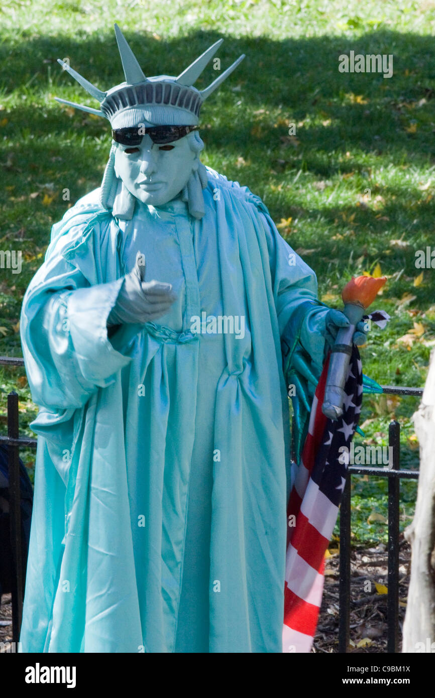 Person dressed as the Statue of Liberty for the Tourists in New York City in Battery Park USA Stock Photo