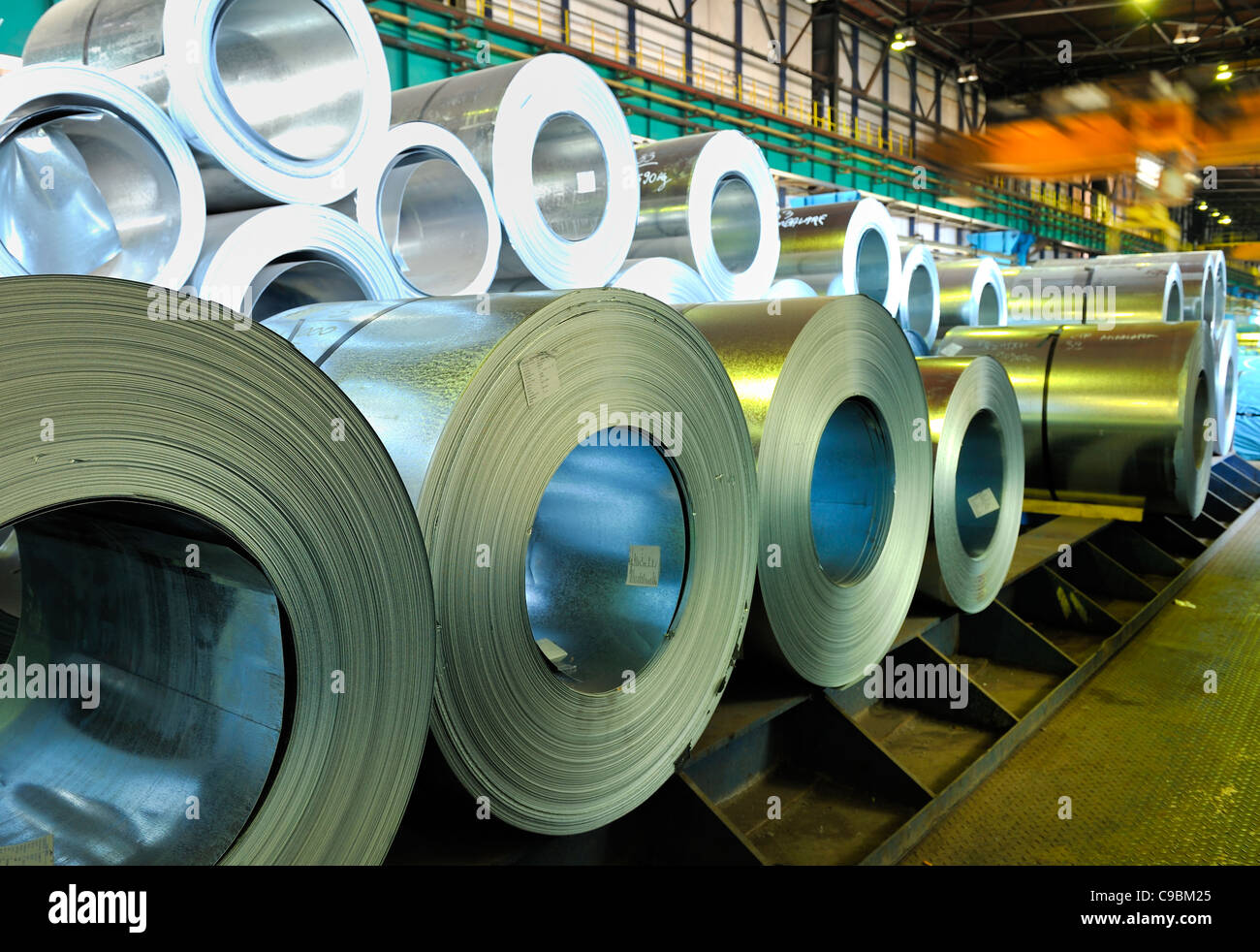 packed rolls of steel sheet - Stock Image