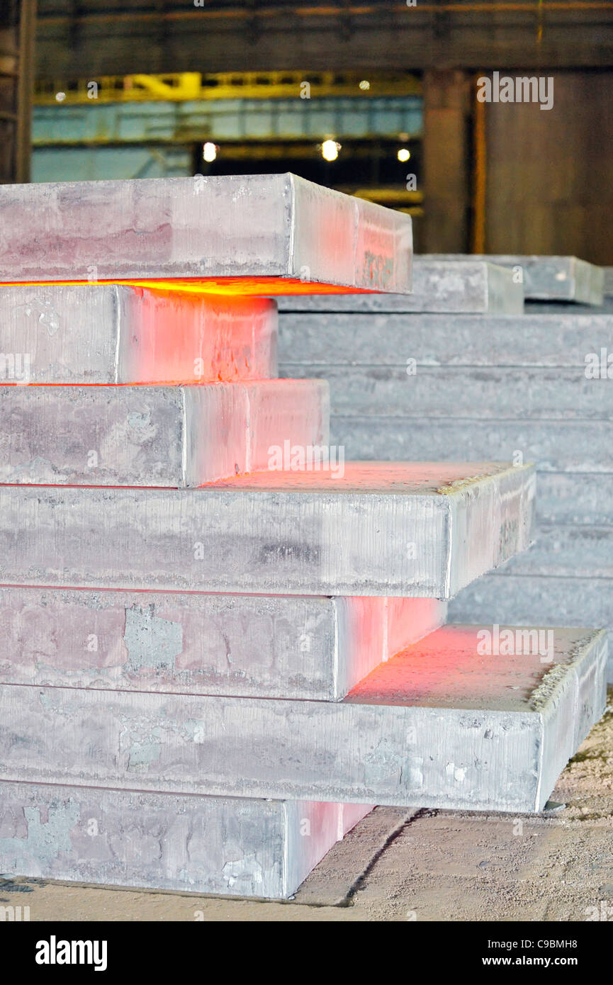 piles of hot steel sheet - Stock Image