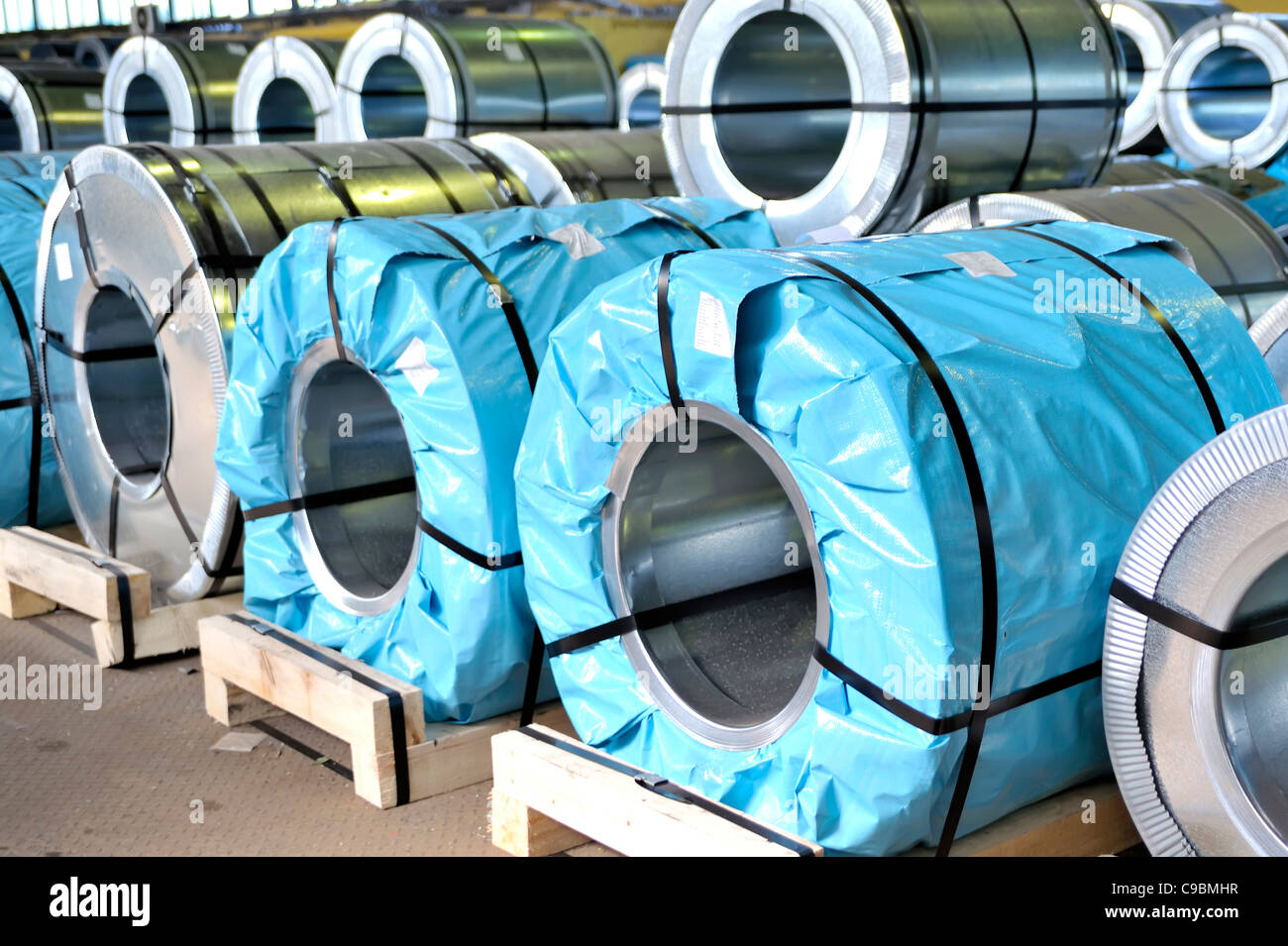 rolls of steel sheet packed - Stock Image