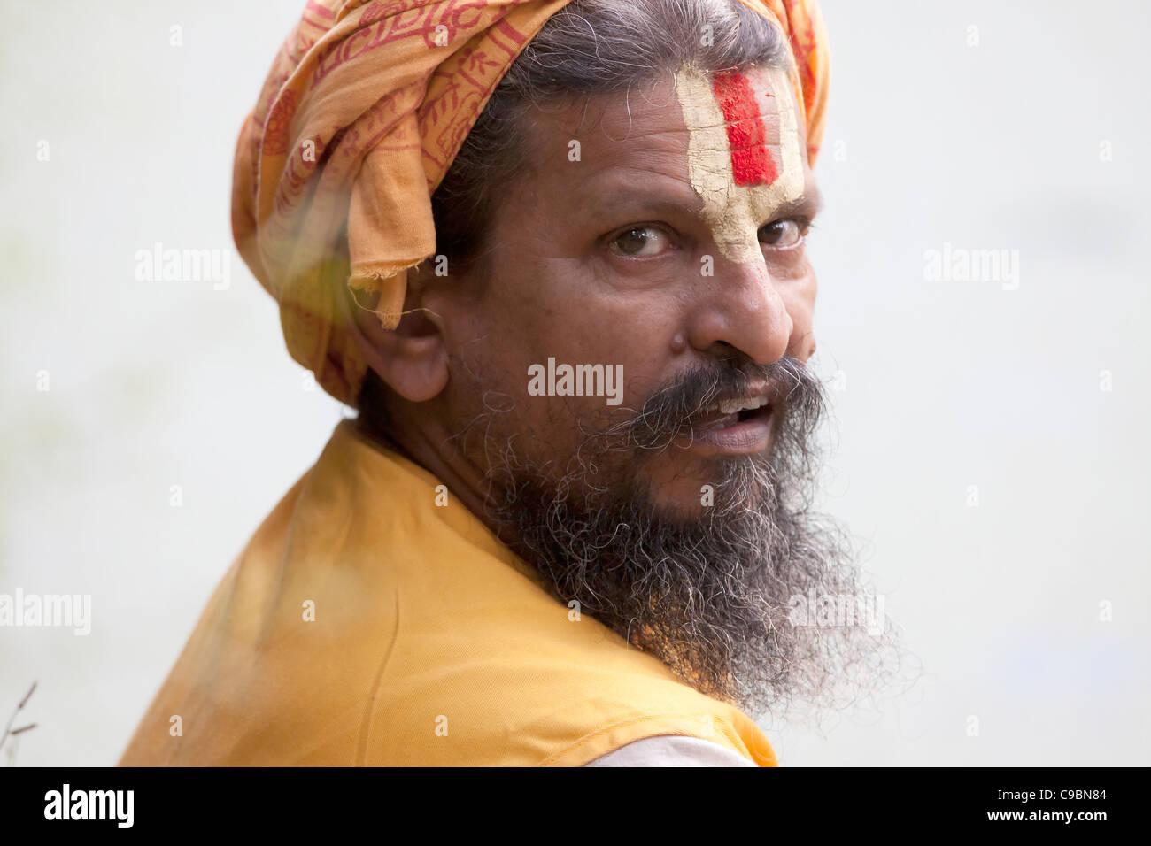 Holy Man Sadhu Religious Traditional Indian Vermilion Tilak Bearded - Stock Image