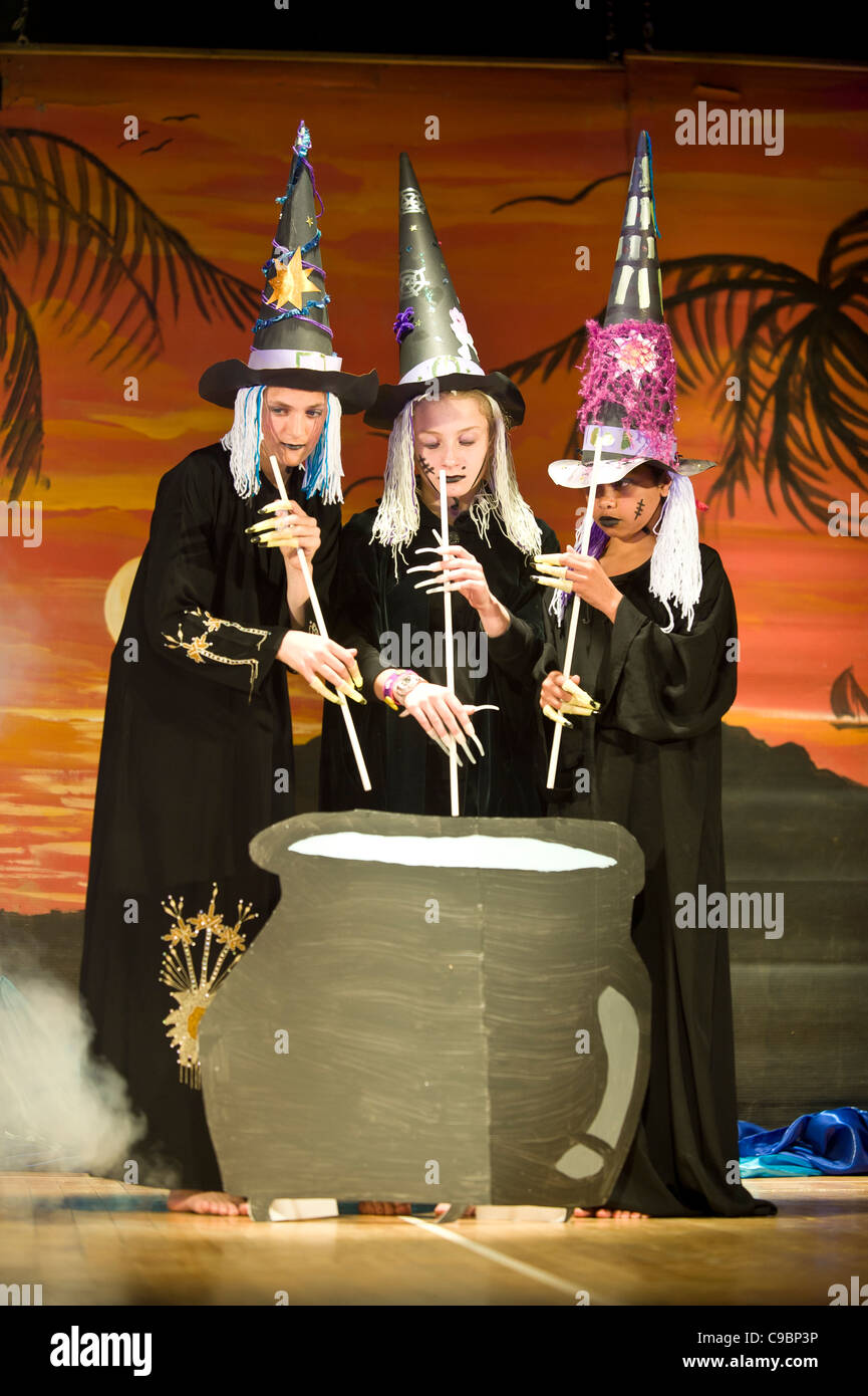 Students performing as witches in a stage play at St Georges School Cape Town South Africa - Stock Image