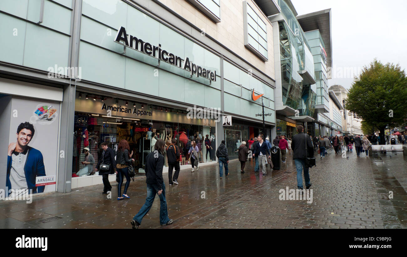 Pedestrians walking past American Apparel store near the Arndale Centre in Central Manchester, England, UK - Stock Image