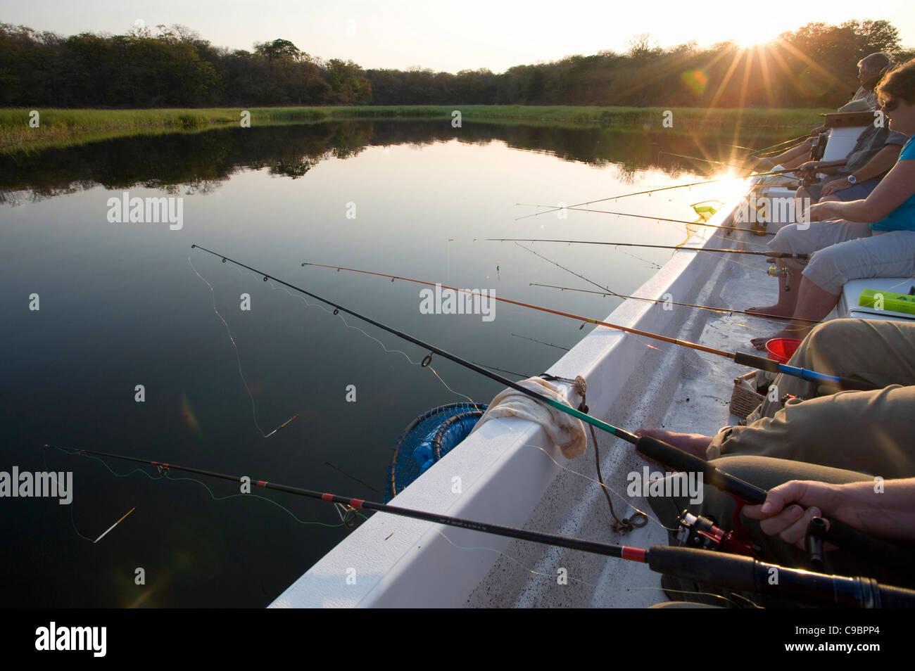 People fishing at Lake Kariba, near Binga, Midlands Province, Zimbabwe - Stock Image