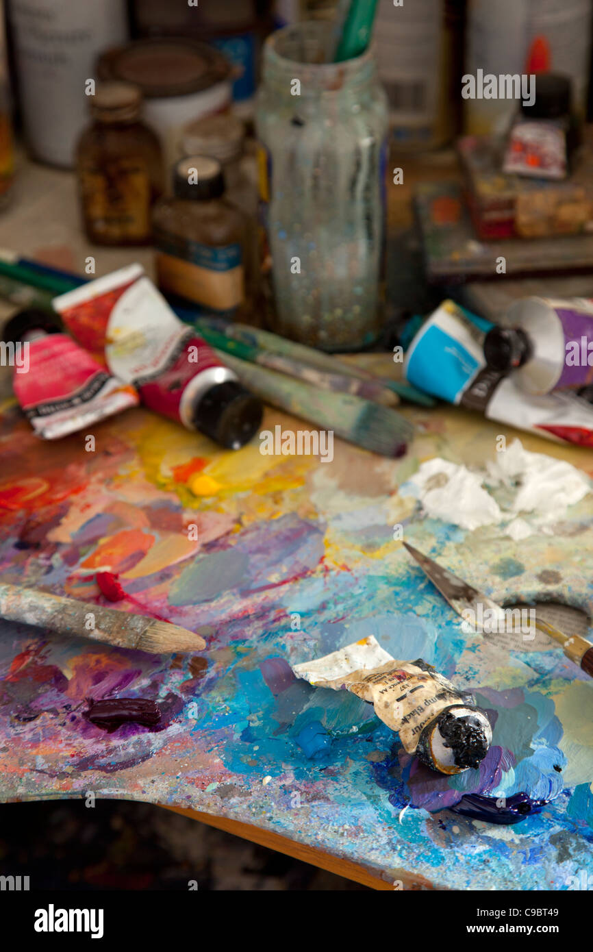 colorful artists Paint oil palette with brushes,knife,spatula,tube oils and jars. - Stock Image