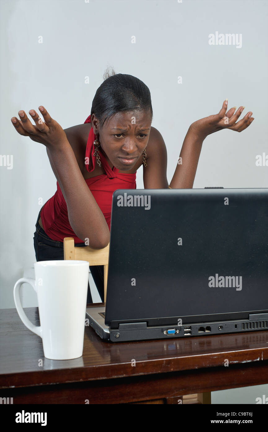 Young Kenyan woman with laptop, Nairobi, Kenya Stock Photo
