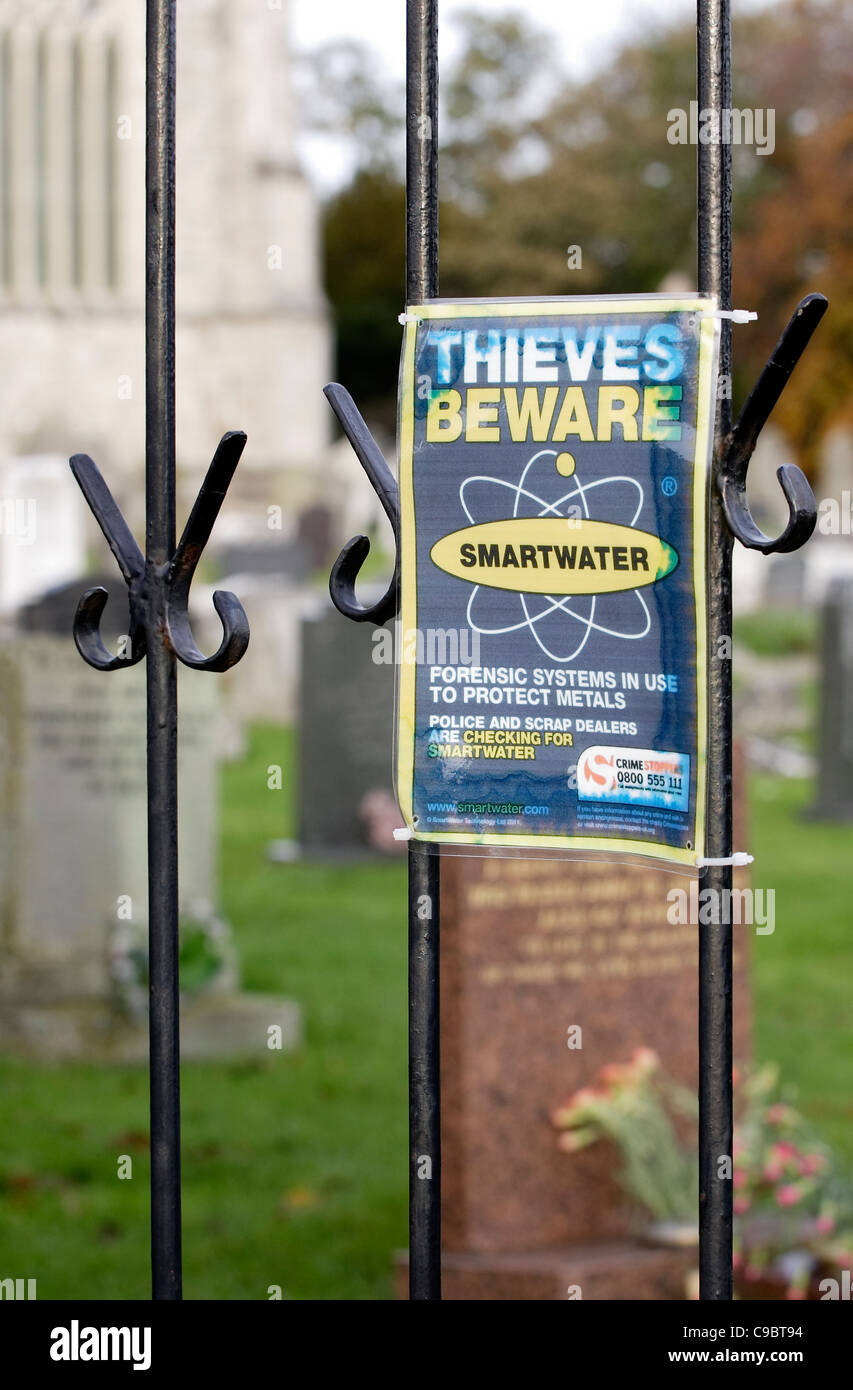 A sign of the times. 'Smartwater' being used to deter scrap metal thieves from a graveyard. - Stock Image