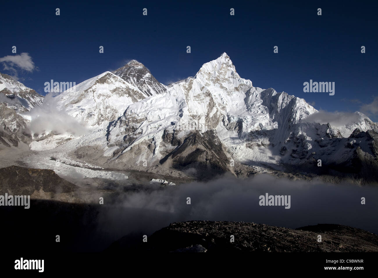 Ice and snow on the mountains of the Everest Range view  from Kala Patar - Everest is the darker peak to the left - Stock Image