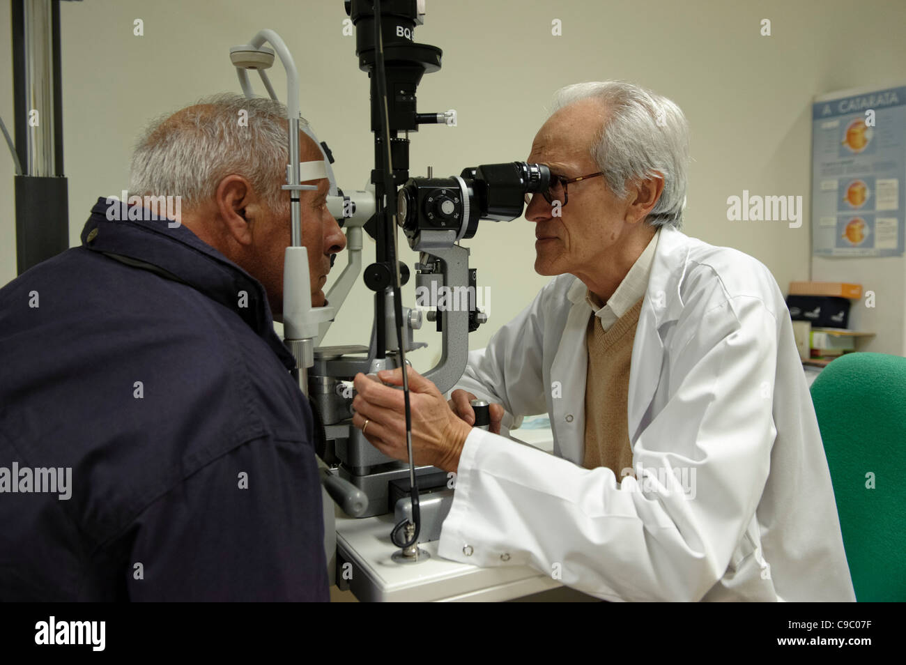 Doctor performing eye test on a patient - Stock Image