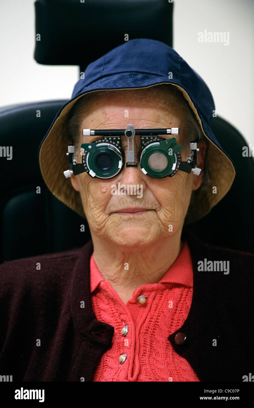 Portrait of an elderly woman having her eyes tested - Stock Image