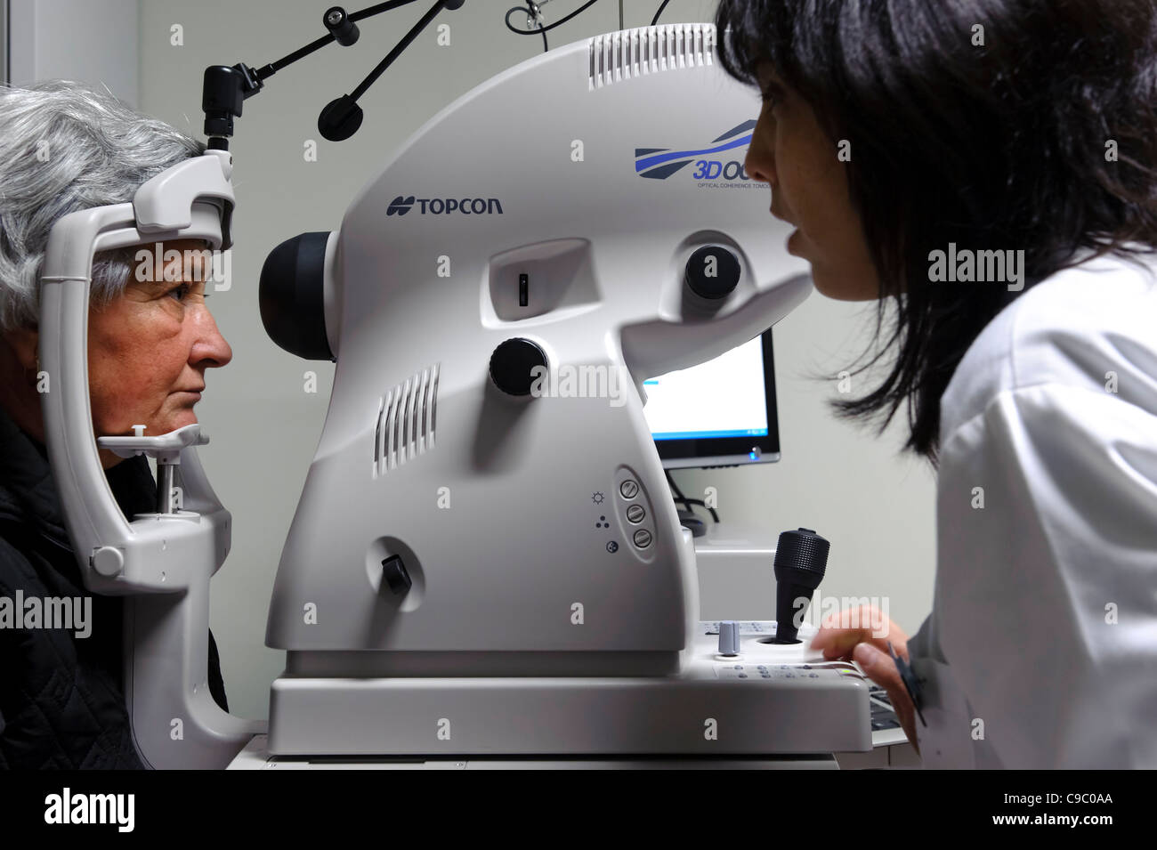 Optical coherence tomography eye exam using a Topcon OCT-1000 medical equipment - Stock Image
