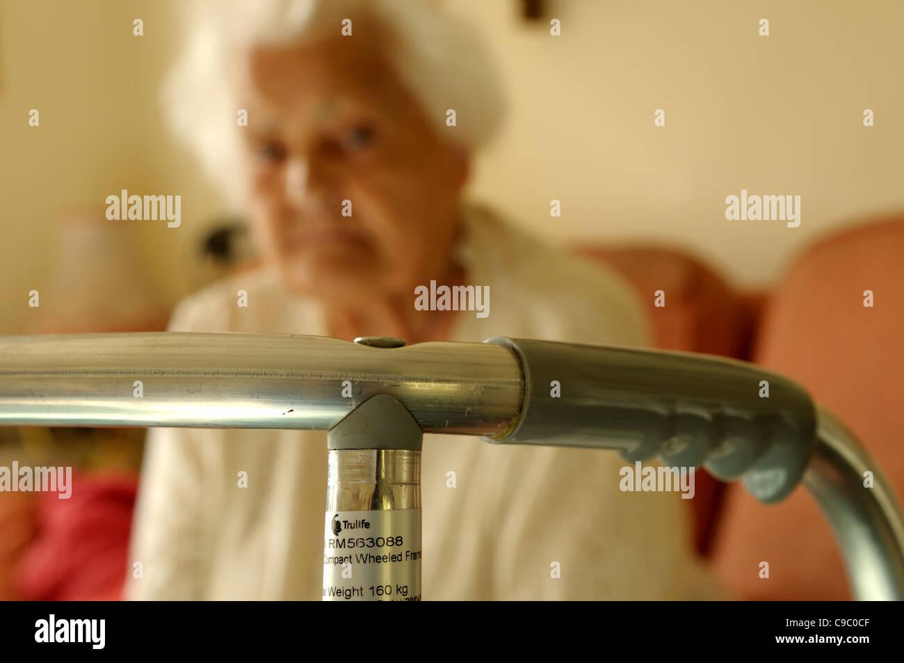 Elderly Women And Walking Frame. Stock Photo