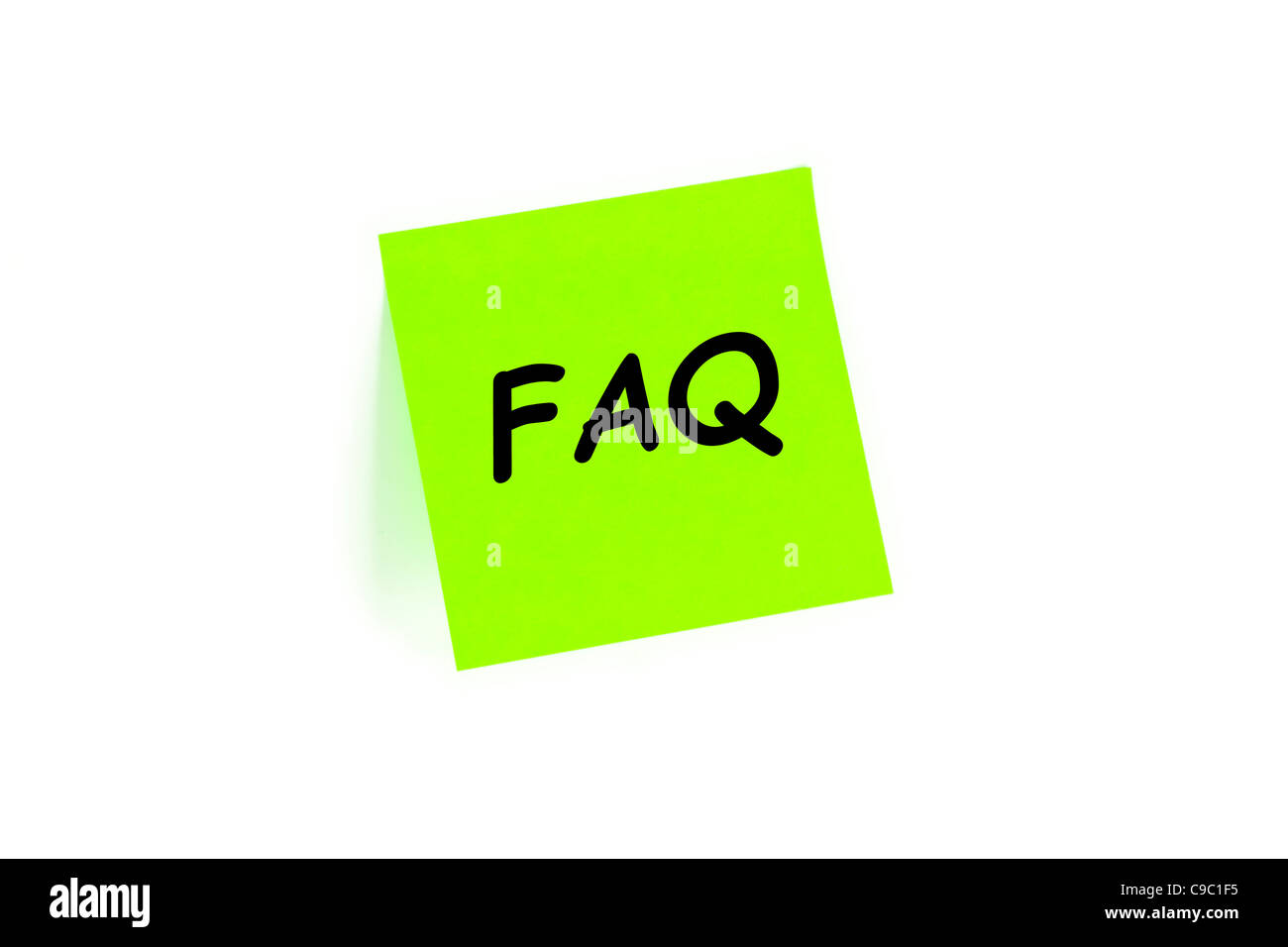 FAQ Frequently Asked Questions Concept On A Note Isolated On White - Stock Image