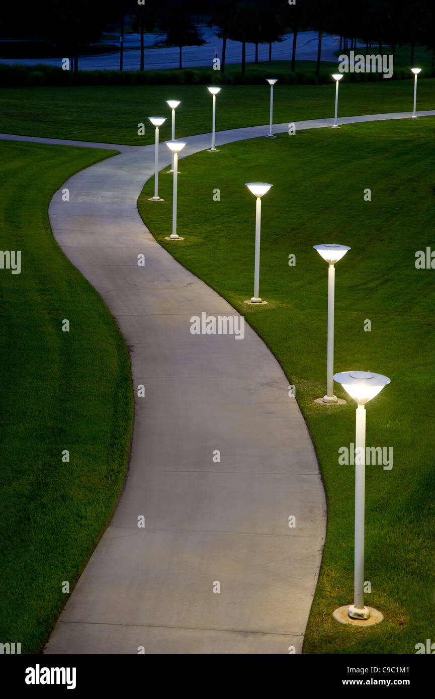 Curved Sidewalk Path At Night With Lights - Stock Image