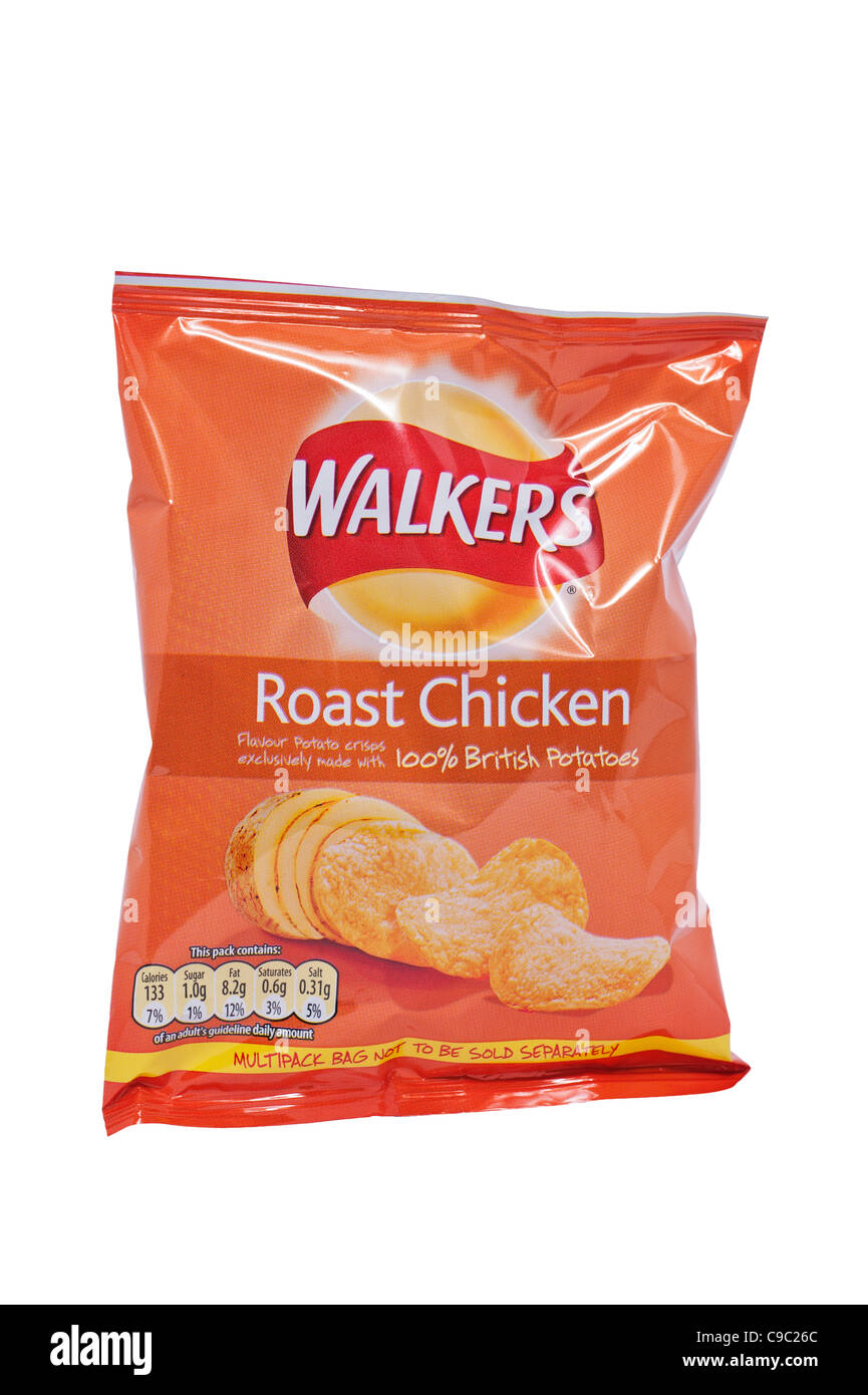 A packet of Walkers roast chicken flavour crisps on a white background - Stock Image