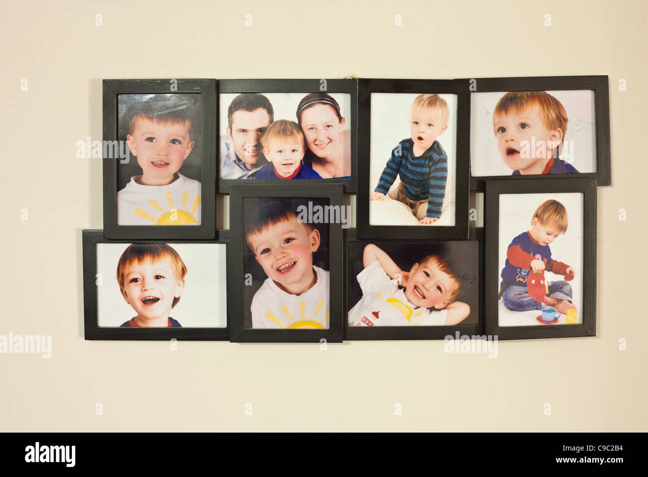 Family pictures in picture frame- model release provided for all faces in the image - Stock Image