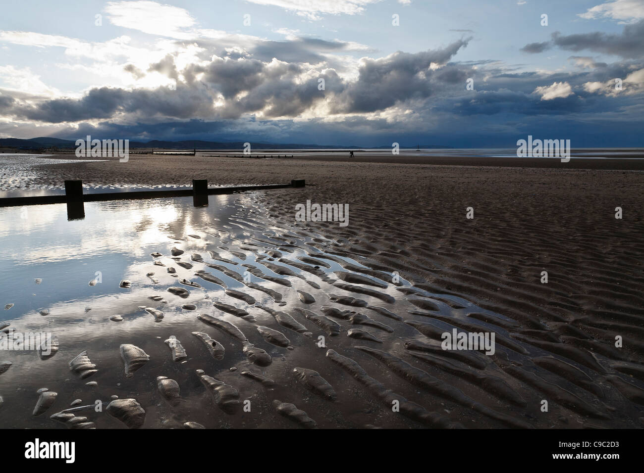 The beach at Rhyl, practically deserted off-season. - Stock Image