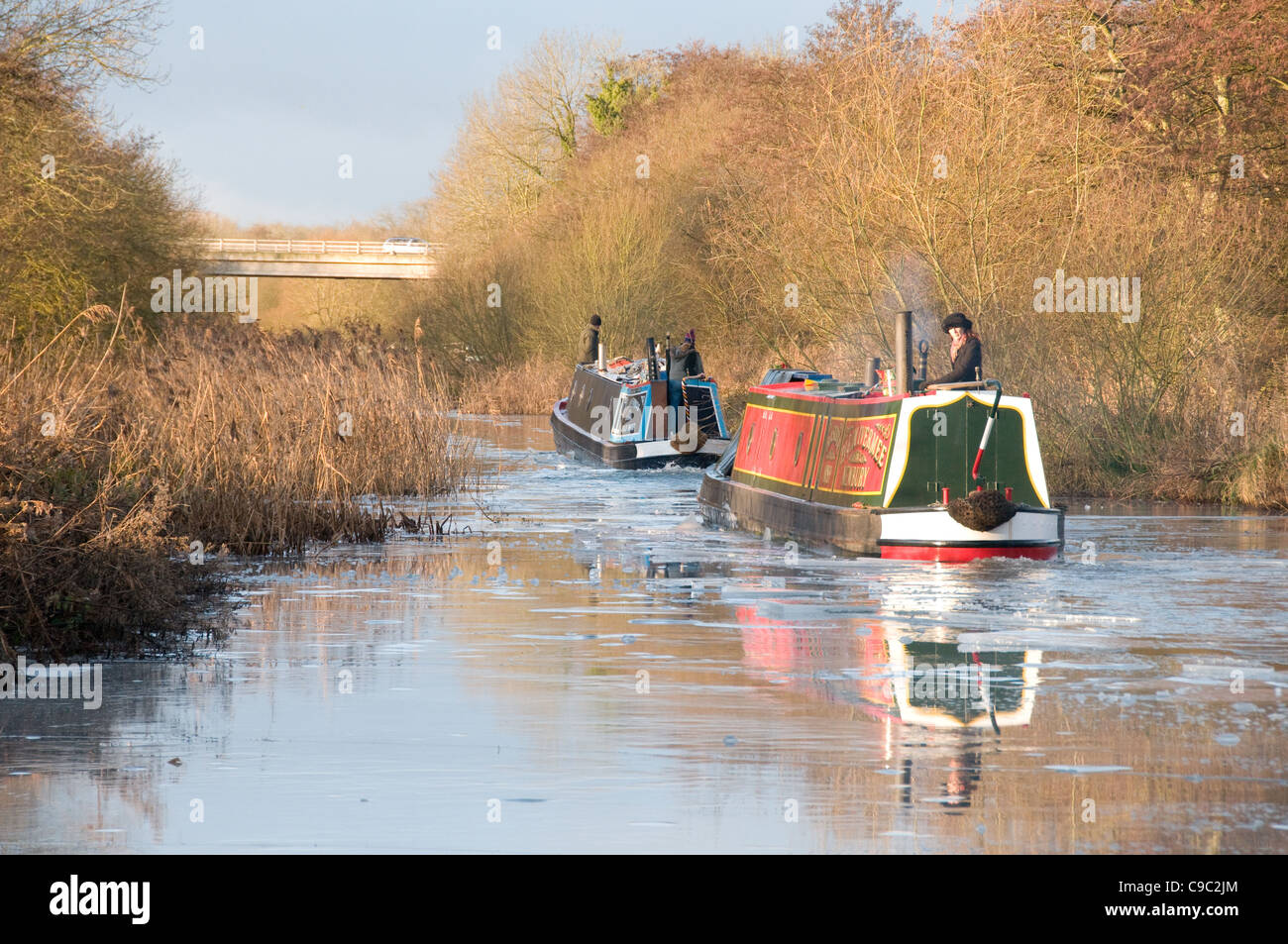 Two narrowboats breaking ice on the Kennet & Avon Canal Nr Newbury Stock Photo