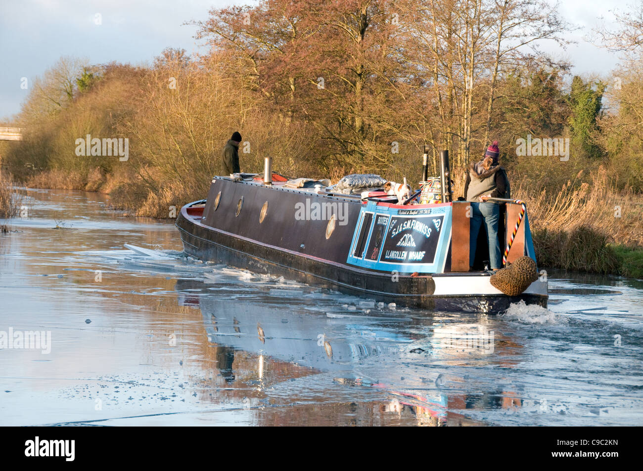 A narrowboat breaking ice on the Kennet & Avon Canal Nr Newbury Stock Photo