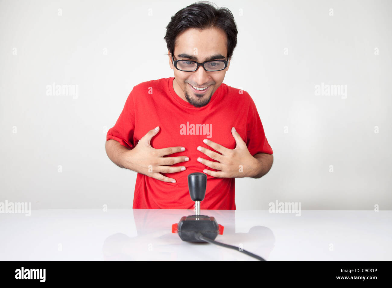 Game nerd excited to see a retro joystick - Stock Image