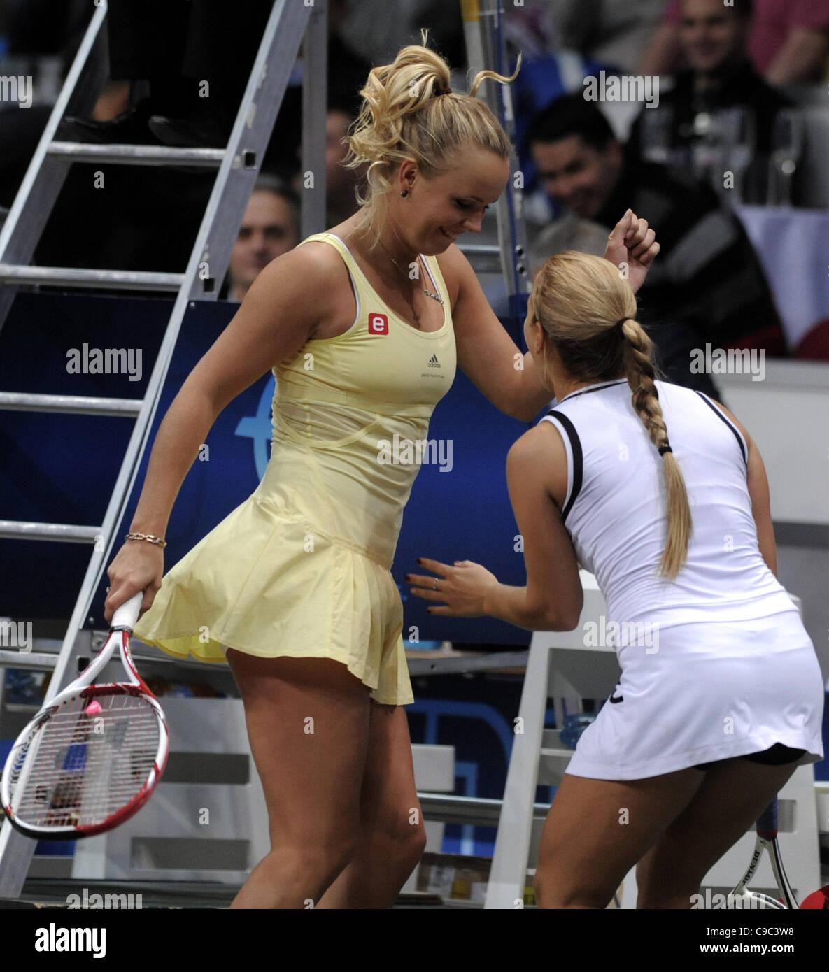 a9511561b112 Denmark s Caroline Wozniacki (left) and Slovak Dominika Cibulkova dance  after the exhibition match Tennis