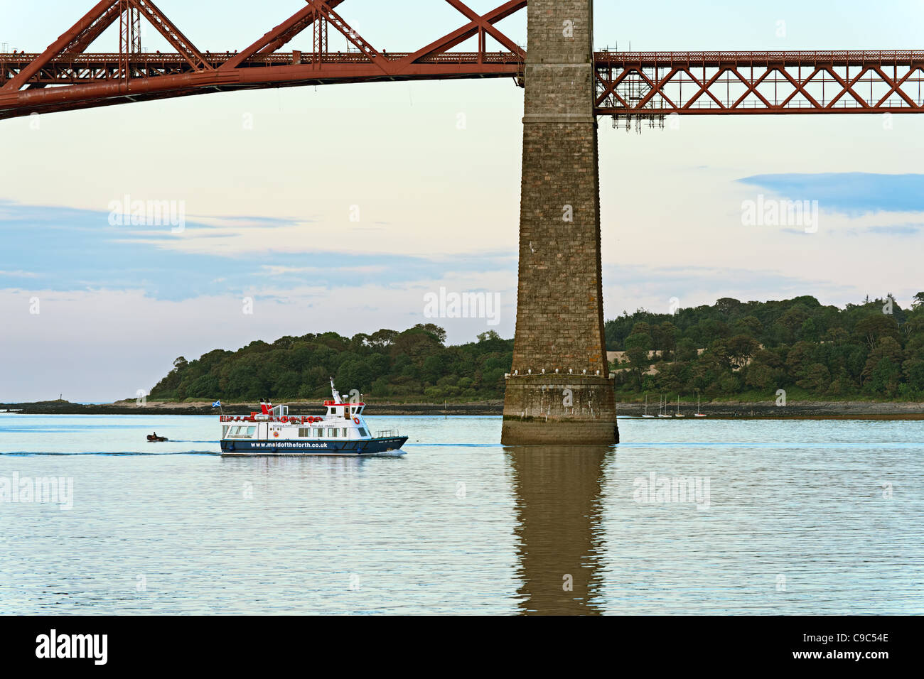 Maid of the Forth, a passenger vessel on the Firth of Forth, cruising past the Forth Rail Bridge, South Queensferry, - Stock Image