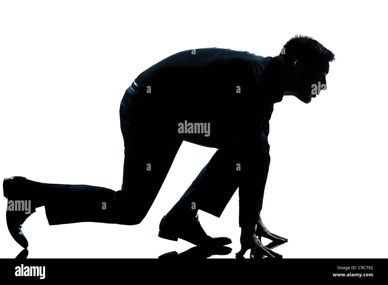 9ab7846dc one caucasian man in starting block posture ready to run full length  silhouette in studio isolated