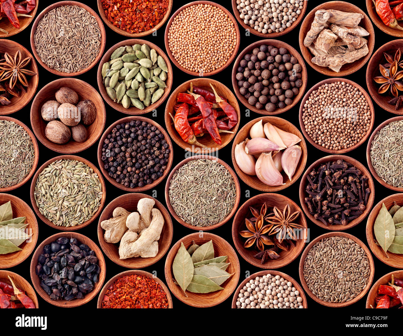 Seamless texture of spices on black background Stock Photo