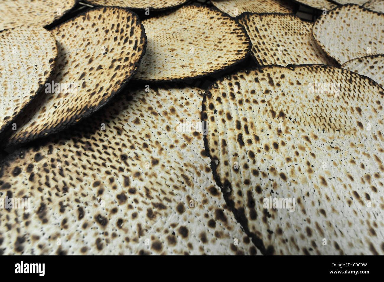 Hand made glatt kosher matzah for the Jewish holiday of Passover - Stock Image