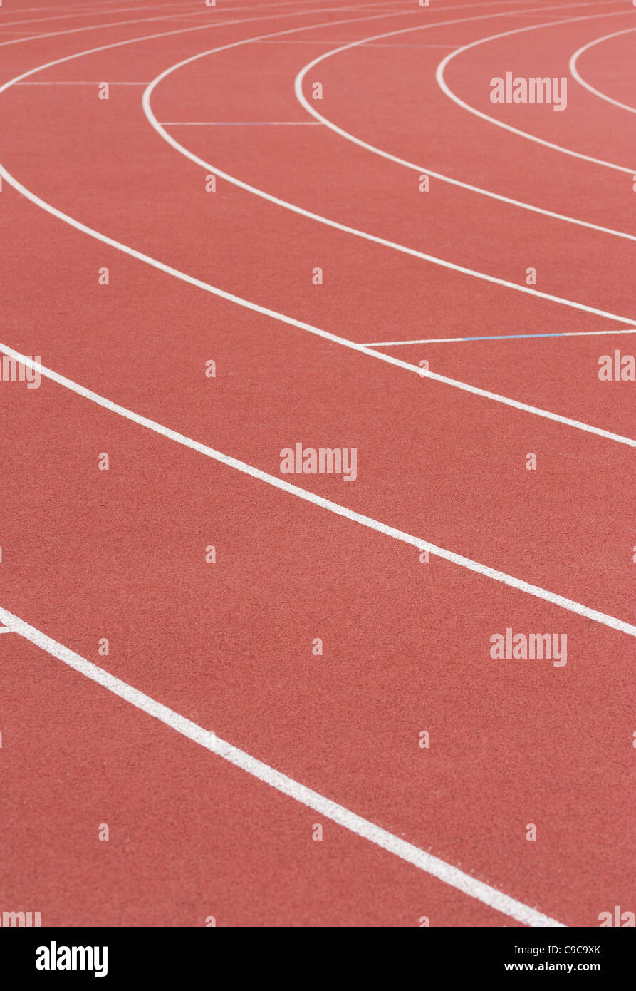 Athletics track with its lane, white lines and turn - Stock Image