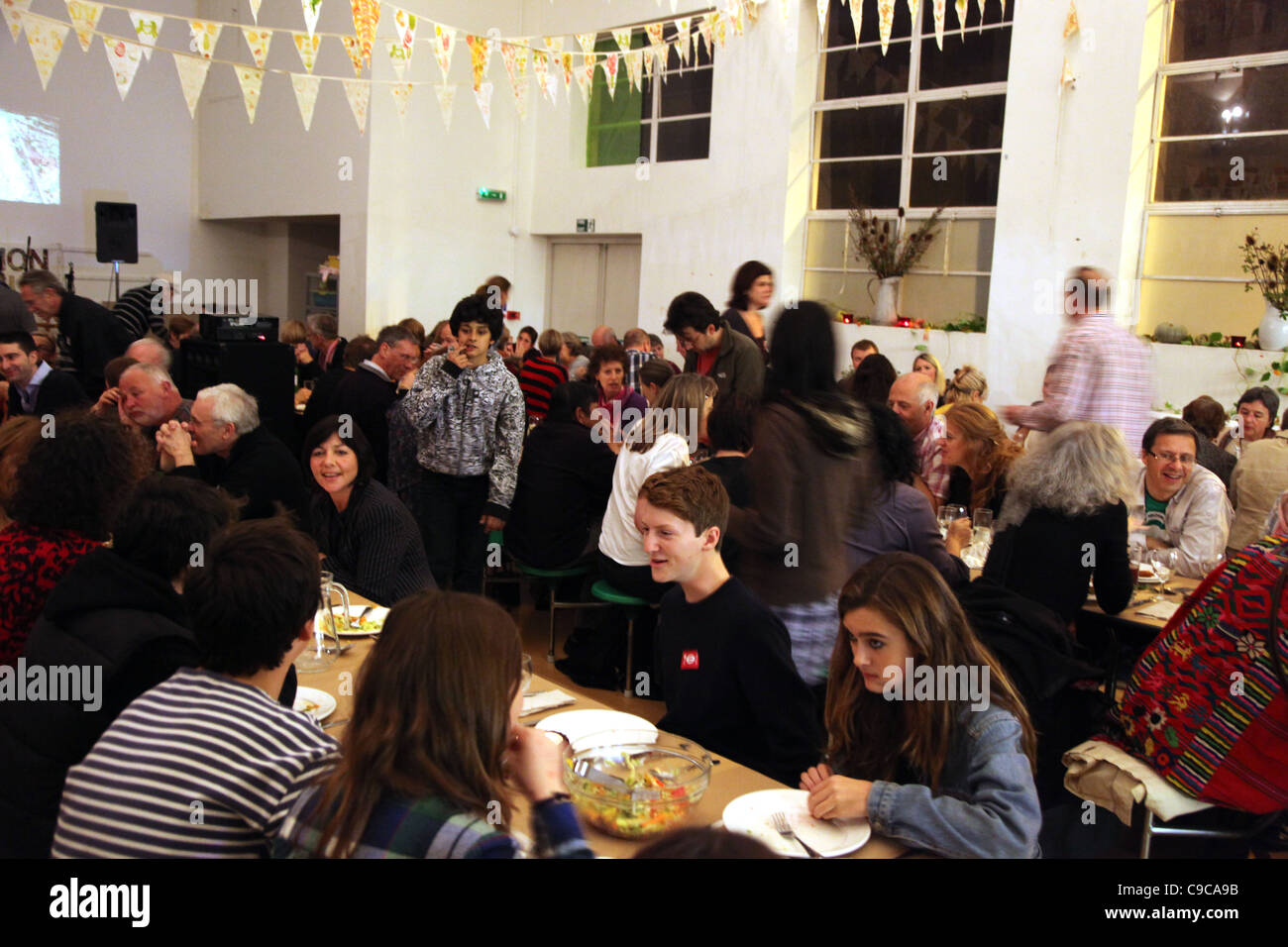 Communal supper at a village hall to celebrate Harvest festival, organised by Transition Town Kensal to Kilburn - Stock Image