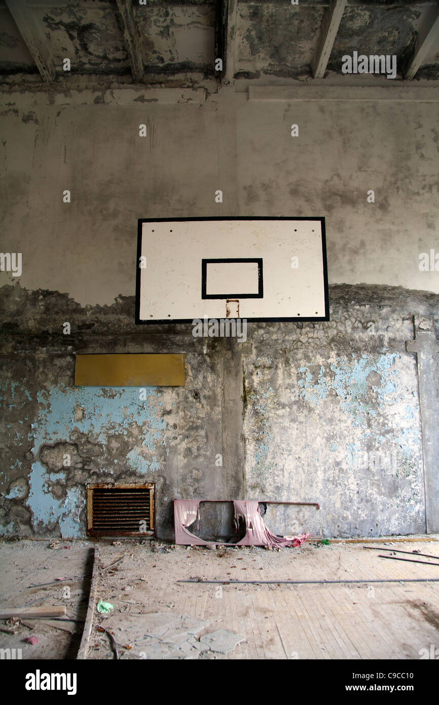 The sports hall  with a basket ball board in Pripyat Middle School Sportivnaya Street, Pripyat Chernobyl exclusion - Stock Image