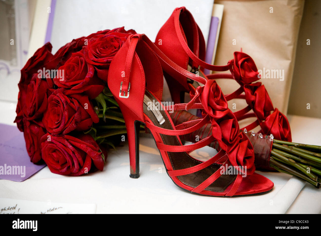 red wedding shoes with red roses and envelopes stock photo 40225587