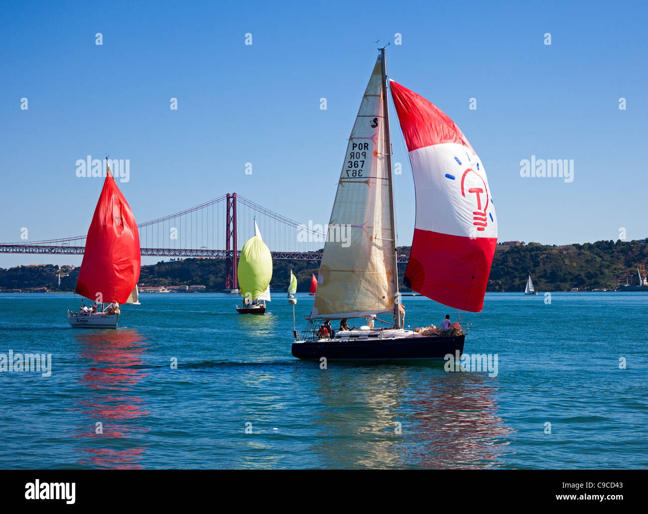Sailing on the River Tagus with the Ponte 25 de Abril Bridge in background Stock Photo