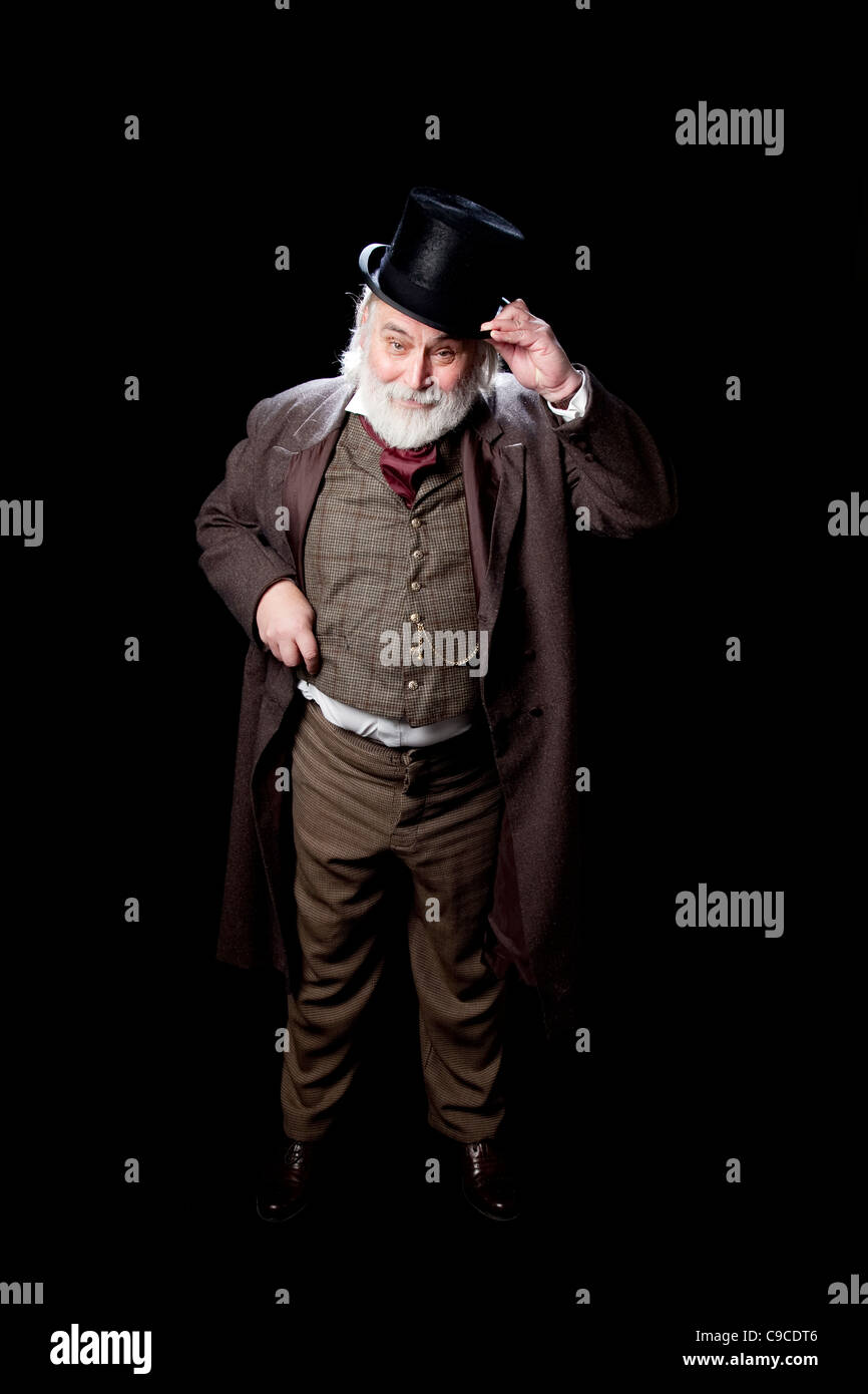 Charles Dickens actor on stag. - Stock Image